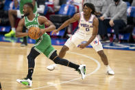 Boston Celtics guard Kemba Walker, left, drives past Philadelphia 76ers guard Tyrese Maxey during the first half of an NBA basketball game Wednesday, Jan. 20, 2021, in Philadelphia. (AP Photo/Chris Szagola)
