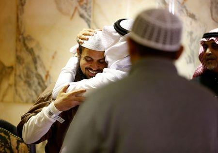 A man kisses the head of a freed Yemeni detainee after his arrival at King Khalid International Airport in Riyadh, Saudi Arabia. REUTERS/Faisal Al Nasser
