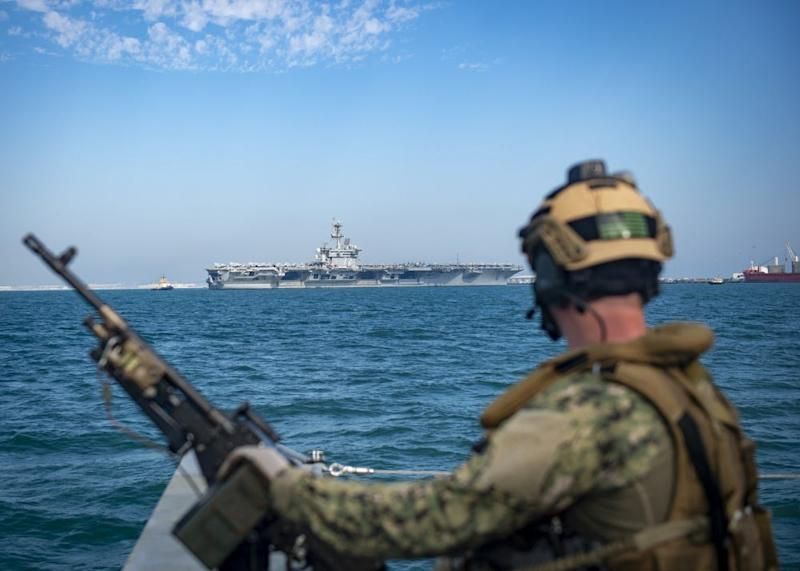 A Sailor assigned to a Mark VI Patrol Boat attached to Commander, Task Force 56 participates in a high value asset (HVA) escort transit of the Nimitz-class aircraft carrier USS Abraham Lincoln (CVN 72) after a port visit in Manama, Bahrain, Dec. 2