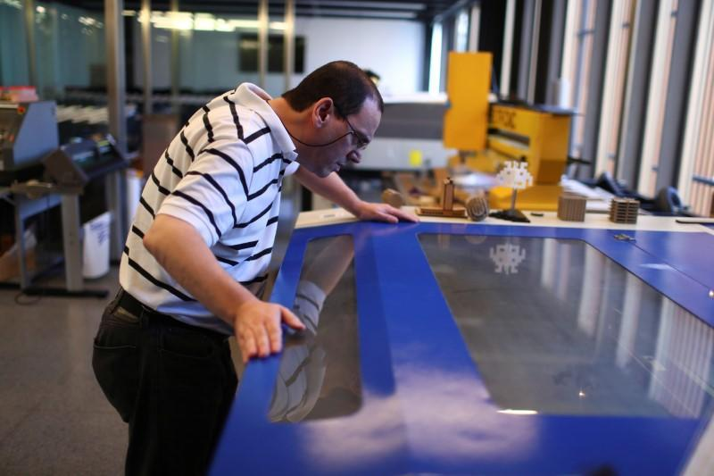 A technical staff works on the 3D printed protective visors made for healthcare professionals, amid the coronavirus disease (COVID-19) outbreak, at the Casa Firjan FabLab in Rio de Janeiro