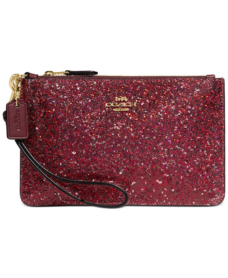 "<p>This shimmery <a href=""https://www.popsugar.com/buy/Coach-Glitter-Leather-Small-Wristlet-522060?p_name=Coach%20Glitter%20Leather%20Small%20Wristlet&retailer=macys.com&pid=522060&price=75&evar1=fab%3Aus&evar9=44306518&evar98=https%3A%2F%2Fwww.popsugar.com%2Fphoto-gallery%2F44306518%2Fimage%2F46933525%2FCoach-Glitter-Leather-Small-Wristlet&list1=shopping%2Cwallets%2Cgift%20guide%2Cfashion%20gifts%2Cgifts%20for%20women%2Cbest%20of%202018&prop13=api&pdata=1"" rel=""nofollow"" data-shoppable-link=""1"" target=""_blank"" class=""ga-track"" data-ga-category=""Related"" data-ga-label=""https://www.macys.com/shop/product/coach-glitter-leather-small-wristlet?ID=9939127&amp;CategoryID=26846&amp;swatchColor=Red%2FGold"" data-ga-action=""In-Line Links"">Coach Glitter Leather Small Wristlet </a> ($75) is great for the holidays or year-round.</p>"