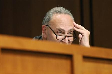 Schumer listens to Kagan on the second day of her Senate confirmation hearings in front of the Senate Judiciary Committee on Capitol Hill in Washington