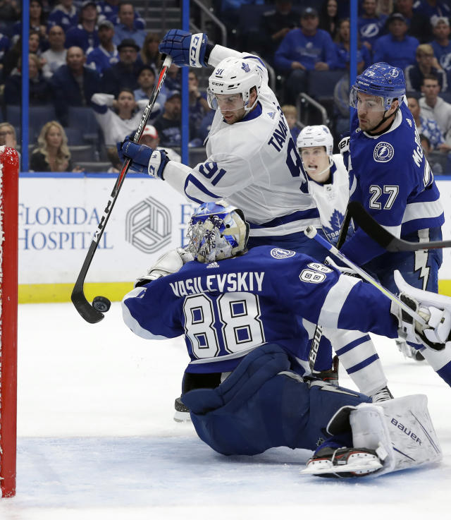 Toronto Maple Leafs center John Tavares (91) tries to bat the puck past Tampa Bay Lightning goaltender Andrei Vasilevskiy (88) during the first period of an NHL hockey game Thursday, Dec. 13, 2018, in Tampa, Fla. (AP Photo/Chris O'Meara)