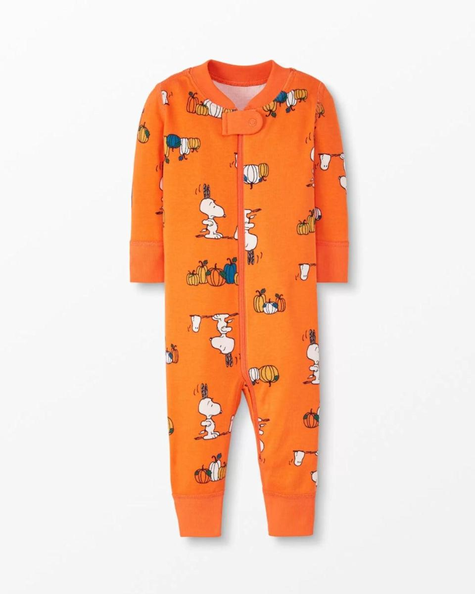 <p>Little ones will get their fill of Snoopy while donning this <span>Peanuts Sleeper In Organic Cotton</span> ($44).</p>