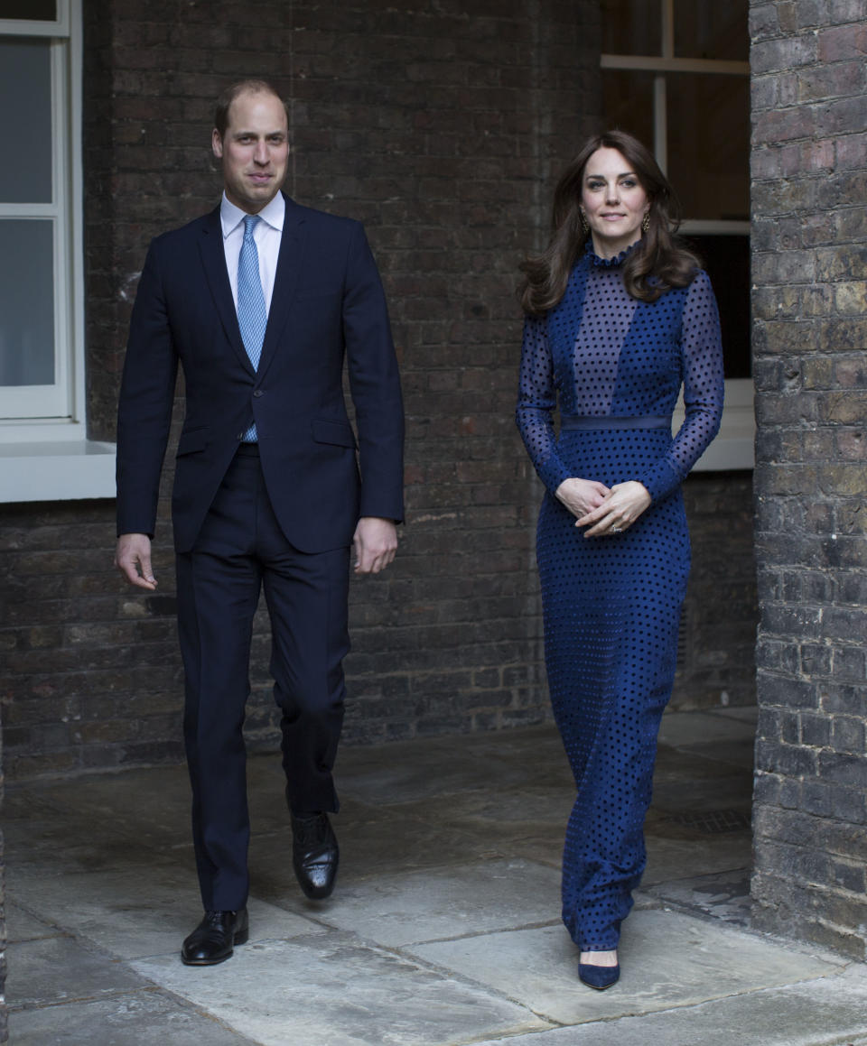 <p>Opting for a navy polka dot gown by Saloni, the Duchess of Cambridge attended a reception at Kensington Palace on April 4, 2016. She finished the look with a pair of co-ordinating Rupert Sanderson heels. <em>[Photo: PA]</em> </p>