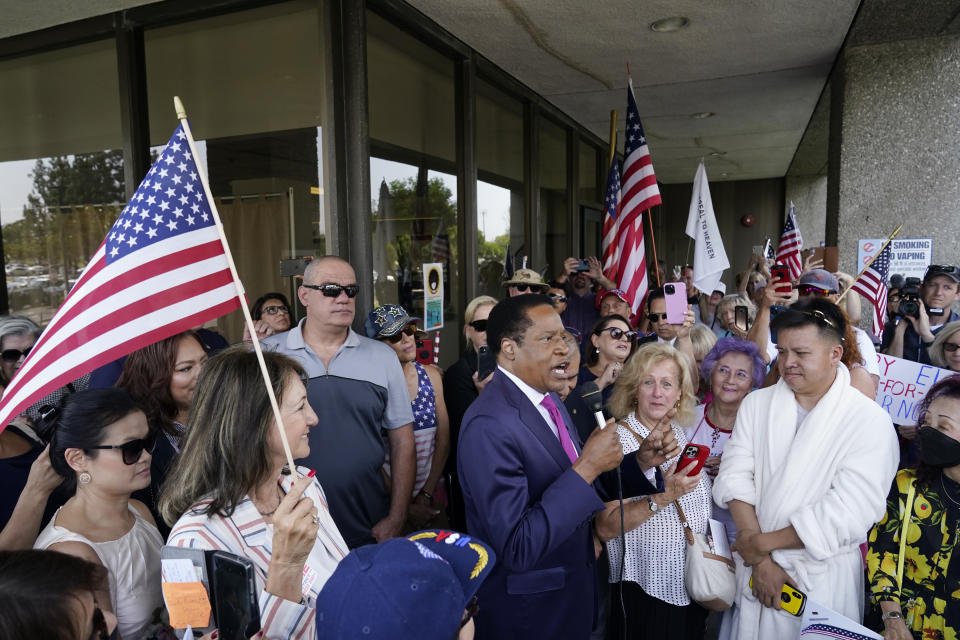 FILE — In this July 13, 2021 file photo conservative radio talk show host Larry Elder speaks to supporters during a campaign stop, in Norwalk, Calif. Elder, who is running to replace Democratic Gov. Gavin Newsom in the Sept. 14 recall election, says he would erase state vaccine and mask mandates, is critical of gun control, opposes the minimum wage and disputes the notion of systemic racism in America. (AP Photo/Marcio Jose Sanchez, File)