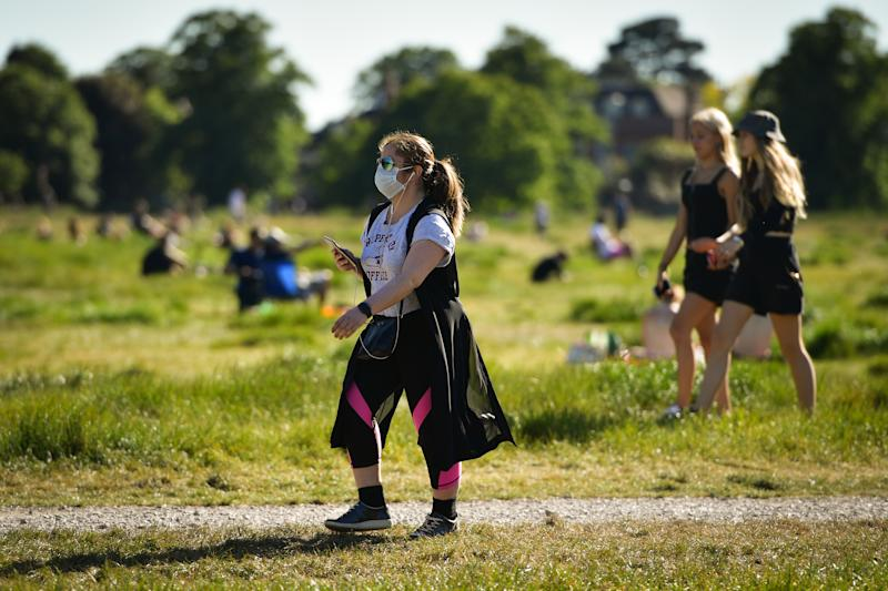 The public enjoying late afternoon sun on Wimbledon Common as the UK eases some restrictions in it's ninth week to help curb the spread of the coronavirus.