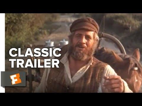 """<p>Based on Sholem Aleichem's Yiddish tale, the 1971 movie-musical is an Oscar-winning adaptation of the Broadway musical. Set in the Pale of Settlement in the early 1900's, the film follows Tevye (Topol), a poor Jewish milkman trying to marry off his daughters while the threat of pogroms loom large over their small village. </p><p><a class=""""link rapid-noclick-resp"""" href=""""https://www.netflix.com/title/499456"""" rel=""""nofollow noopener"""" target=""""_blank"""" data-ylk=""""slk:Watch Now"""">Watch Now</a></p><p><a href=""""https://www.youtube.com/watch?v=gsDP-90j9x8"""" rel=""""nofollow noopener"""" target=""""_blank"""" data-ylk=""""slk:See the original post on Youtube"""" class=""""link rapid-noclick-resp"""">See the original post on Youtube</a></p>"""
