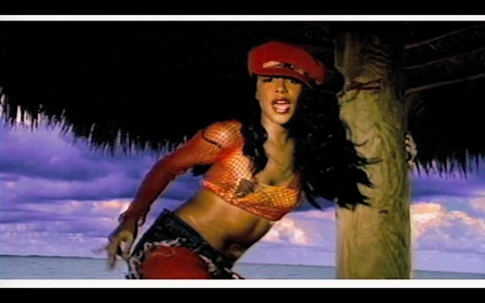 """<cite class=""""credit"""">Screenshot/Youtube. """"Rock The Boat"""" music video, Aaliyah.</cite>"""