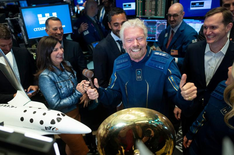 Richard Branson, Founder of Virgin Galactic (C) poses next to George T. Whitesides (R), CEO of Virgin Galactic Holdings after ringing the First Trade Bell to commemorate the company's first day of trading on the New York Stock Exchange (NYSE) on October 28, 2019 in New York City. (Photo by Johannes EISELE / AFP) (Photo by JOHANNES EISELE/AFP via Getty Images)