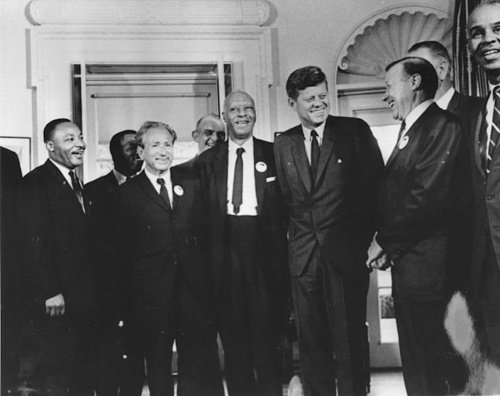 28th August 1963: American president John F. Kennedy in the White House with leaders of the civil rights 'March on Washington' (left to right) Dr Martin Luther King (1929 – 1968), John Lewis, Rabbi Joachim Prinz, A. Philip Randolph, President Kennedy, Walter Reuther (1907 – 1970) and Roy Wilkins. Behind Reuther is Vice-President Lyndon Johnson. (Photo by Three Lions/Hulton Archive/Getty Images)
