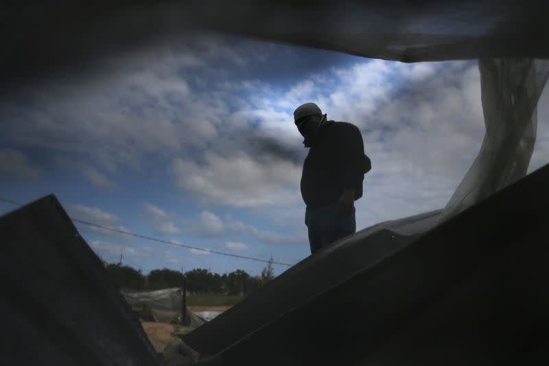 A Palestinian militant surveys an Islamic Jihad site that was targeted in an Israeli air strike in the southern Gaza Strip