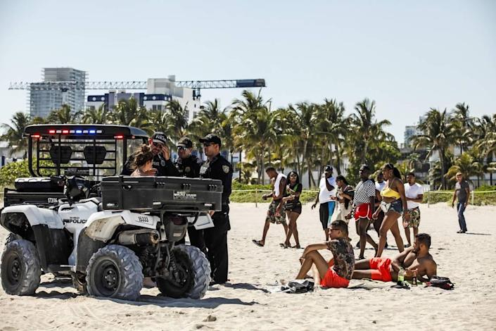 Miami Beach Police interact with spring breakers in March 2019.