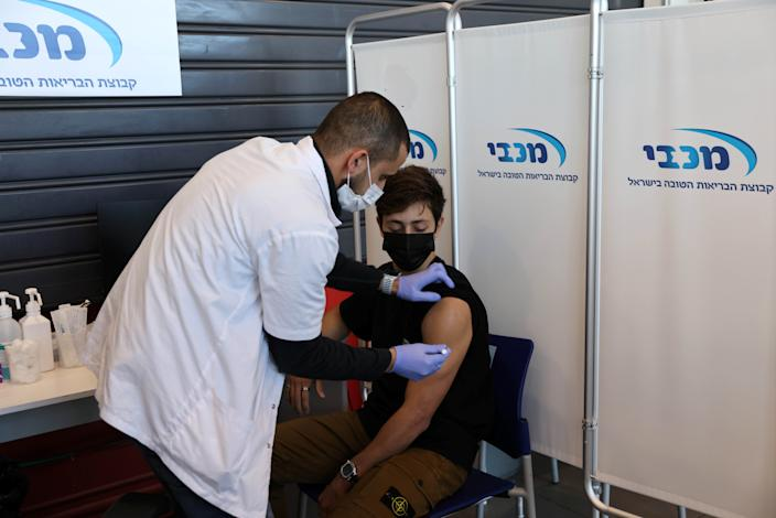 A teenager receives a vaccination against the coronavirus disease (COVID-19), in Tel Aviv, Israel, January 24, 2021. (Ronen Zvulun/Reuters)