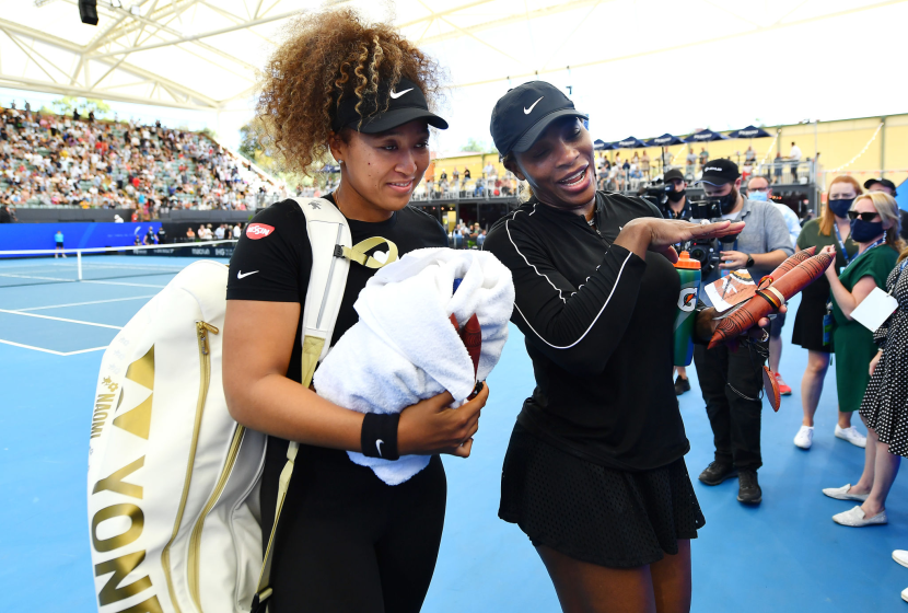 Naomi Osaka and Serena Williams of the USA leave the court after an exibition match January 29 in Adelaide, Australia.