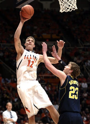 Illinois center Meyers Leonard (12) puts up a shot over Michigan forward Evan Smotrycz (23) in the first half of an NCAA college basketball game in Champaign, Ill., on Thursday, March 1, 2012. (AP Photo/John Dixon)