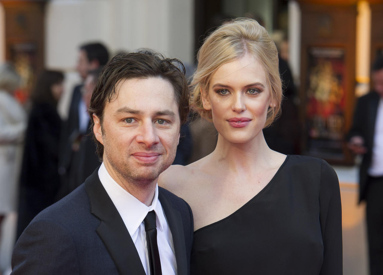 U.S. actor Zach Braff and U.S. model Taylor Bagley arrives for the Olivier Awards at the Royal Opera House, London, Sunday, April 15, 2012. (AP Photo/Jonathan Short)