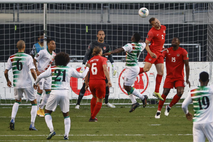 Canada's Alistair Johnston (2) goes for a header as he defends against Suriname during the first half of a World Cup 2022 Group B qualifying soccer match Tuesday, June 8, 2021, in Bridgeview, Ill. (AP Photo/Kamil Krzaczynski)