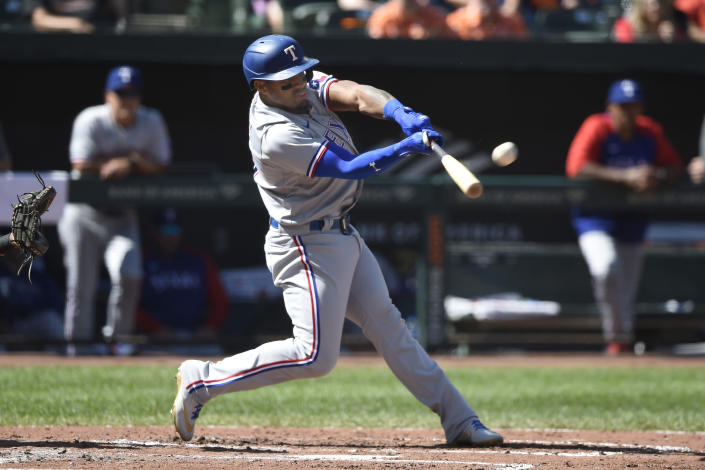 Texas Rangers' Andy Ibanez connects for a two-run home run against the Baltimore Orioles in the fourth inning of a baseball game Sunday, Sept. 26, 2021, in Baltimore. (AP Photo/Gail Burton)