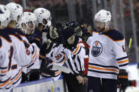 Edmonton Oilers defenseman Adam Larsson is congratulated after scoring a goal during the first period of an NHL hockey game against the Florida Panthers, Saturday, Feb. 15, 2020, in Sunrise, Fla. (AP Photo/Lynne Sladky)
