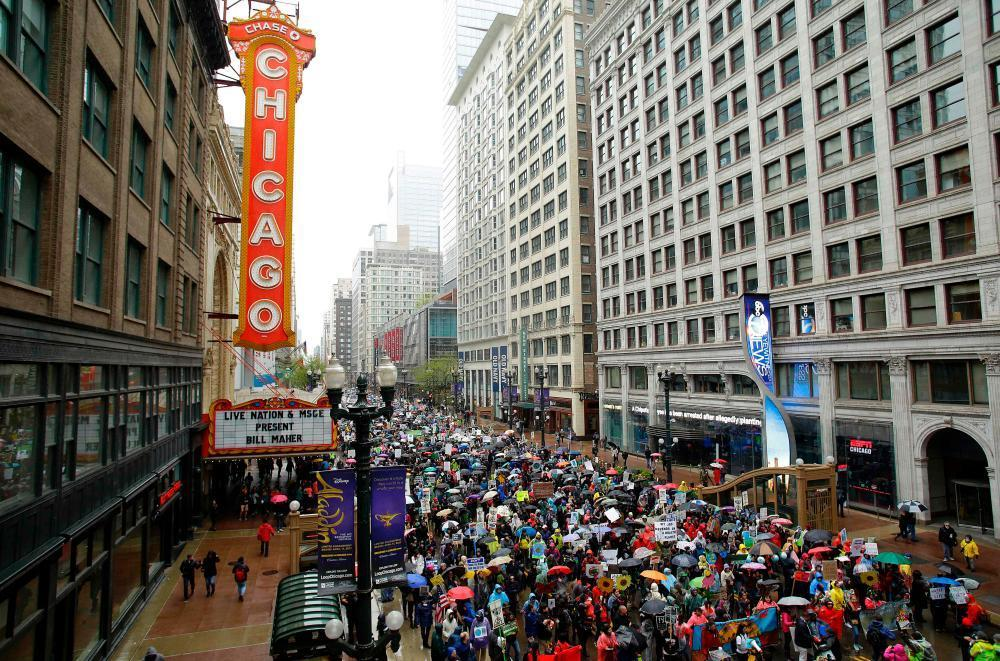 "<span class=""element-image__caption"">Demonstrators march in Chicago.</span> <span class=""element-image__credit"">Photograph: Joshua Lott/AFP/Getty Images</span>"