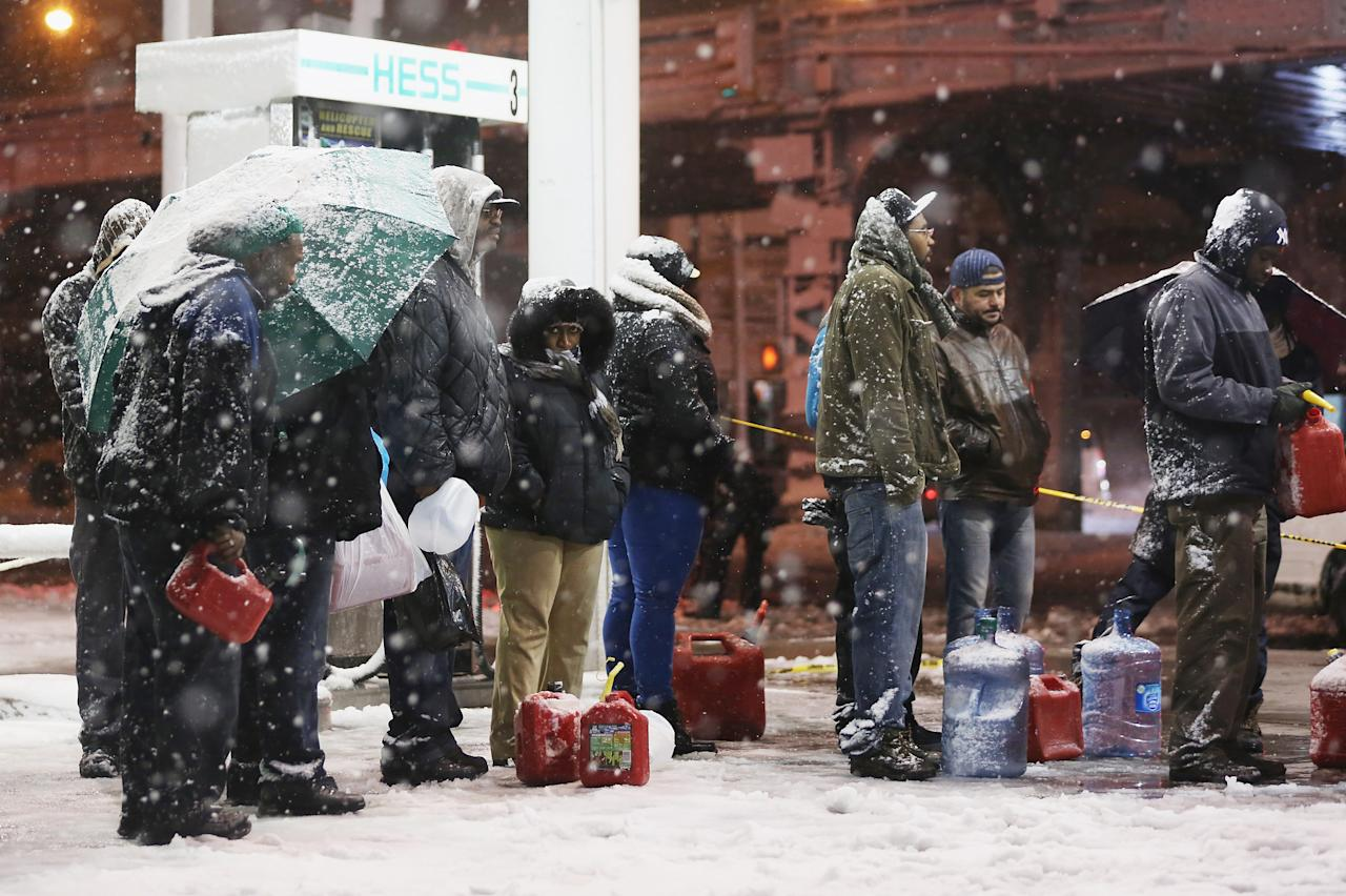 People wait on line to buy gasoline during a Nor?Easter snowstorm on November 7, 2012 in the Brooklyn borough of New York City. The city is still experiencing long gas lines in the wake of Superstorm Sandy.  (Photo by Mario Tama/Getty Images)