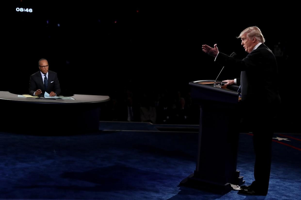Donald Trump speaks as moderator Lester Holt looks on at the presidential debate. (Photo: Joe Raedle/Getty Images)