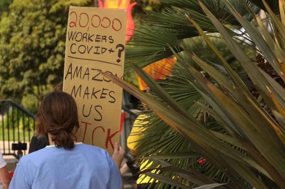 BEVERLY HILLS, CA - OCTOBER 04, 2020 - Protesters rally in Will Rogers Park before marching to Amazon founder Jeff Bezos' mansion to lobby for higher wages, the right to unionize and a series of reforms in the way the giant company handles the COVID-19 crisis in Beverly Hills on October 4, 2020. Demonstrators ended their march at the front gate of Bezos home. The event was organized by The Congress of Essential Workers and led by Chris Smalls, a former Amazon employee in Staten Island, N.Y., who was fired in March shortly after he helped organize a work stoppage at the company's warehouse to protest what he called a lack of protective gear and hazard pay for employees. (Genaro Molina / Los Angeles Times via Getty Images)