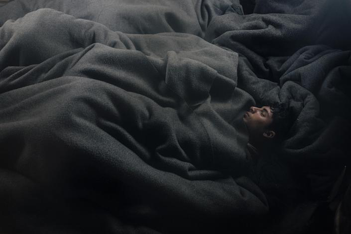 <p>Lives In limbo: Young Afghans sleep in an abandoned train wagon in Belgrade, Serbia, Jan. 12, 2017.<br>The tightening of the so-called Balkan route into the European Union stranded thousands of refugees attempting to travel through Serbia to seek a new life in Europe. Many spent the freezing winter in derelict warehouses behind Belgrade's main train station. The UNHCR reported that the number of refugees in Serbia had increased from 2,000 in June 2016 to more than 7,000 by the end of the year. Some 85 percent were accommodated in government facilities, most of the others slept rough in the capital. (Photo: Francesco Pistilli) </p>