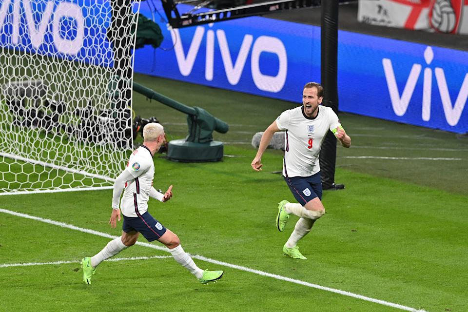 LONDON, ENGLAND - JULY 07: Harry Kane of England celebrates with Phil Foden after scoring their side's second goal during the UEFA Euro 2020 Championship Semi-final match between England and Denmark at Wembley Stadium on July 07, 2021 in London, England. (Photo by Justin Tallis - Pool/Getty Images)