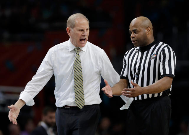 Michigan head coach John Beilein argues a call with a referee during the first half in the championship game of the Final Four NCAA college basketball tournament against Villanova, Monday, April 2, 2018, in San Antonio. (AP Photo/David J. Phillip)