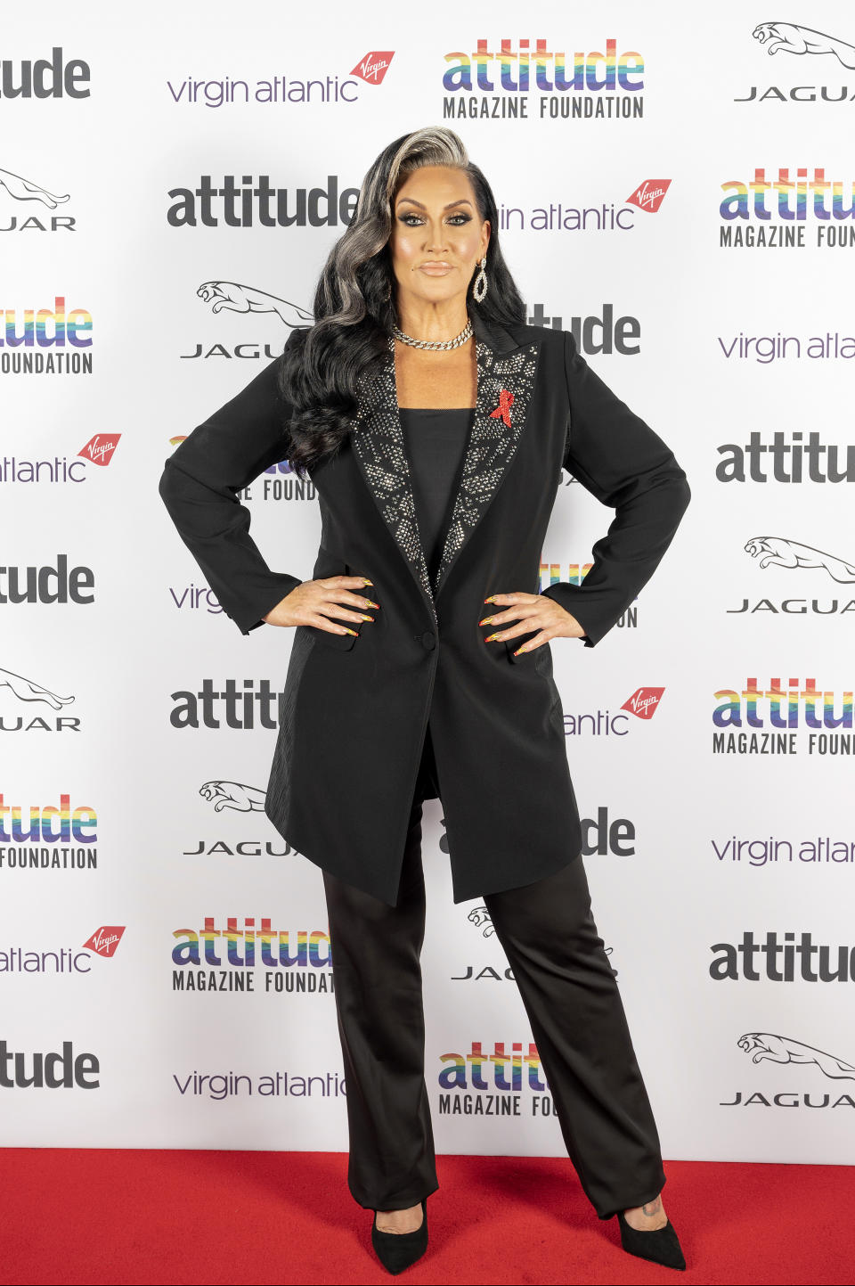 Michelle Visage poses on the red carpet during the Virgin Atlantic Attitude Awards Powered By Jaguar broadcast on December 01, 2020 in London, England. (Photo by Attitude Magazine/Attitude Magazine via Getty Images)