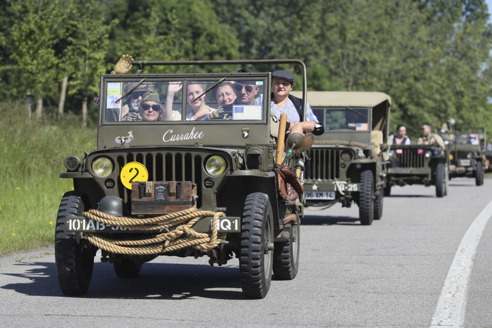 World War II history enthusiasts parade in WWII vehicles in Ouistreham, Normandy, Saturday June, 5 2021 on the eve of 77th anniversary of the assault that helped bring an end to World War II. While France is planning to open up to vaccinated visitors starting next week, that comes too late for the D-Day anniversary. So for the second year in a row, most public commemoration events have been cancelled. A few solemn ceremonies have been maintained, in the presence of dignitaries and a few guests only. (AP Photo/David Vincent)