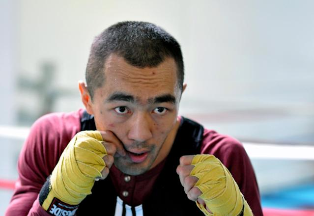 In this photo taken April 5, 2014, WBA and IBA light heavyweight boxing champion Beibut Shumenov, of Kazakhstan, poses in Las Vegas. Shumenov and IBF light heavyweight champion Bernard Hopkins will fight at the DC Armory on Saturday, April 19. (AP Photo/Joe Coomber)