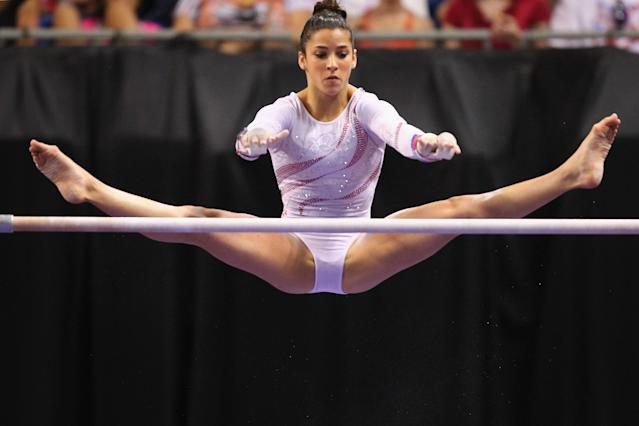 ST. LOUIS, MO - JUNE 10: Alexandra Raisman competes on the uneven bars during the Senior Women's competition on day four of the Visa Championships at Chaifetz Arena on June 10, 2012 in St. Louis, Missouri. (Photo by Dilip Vishwanat/Getty Images)