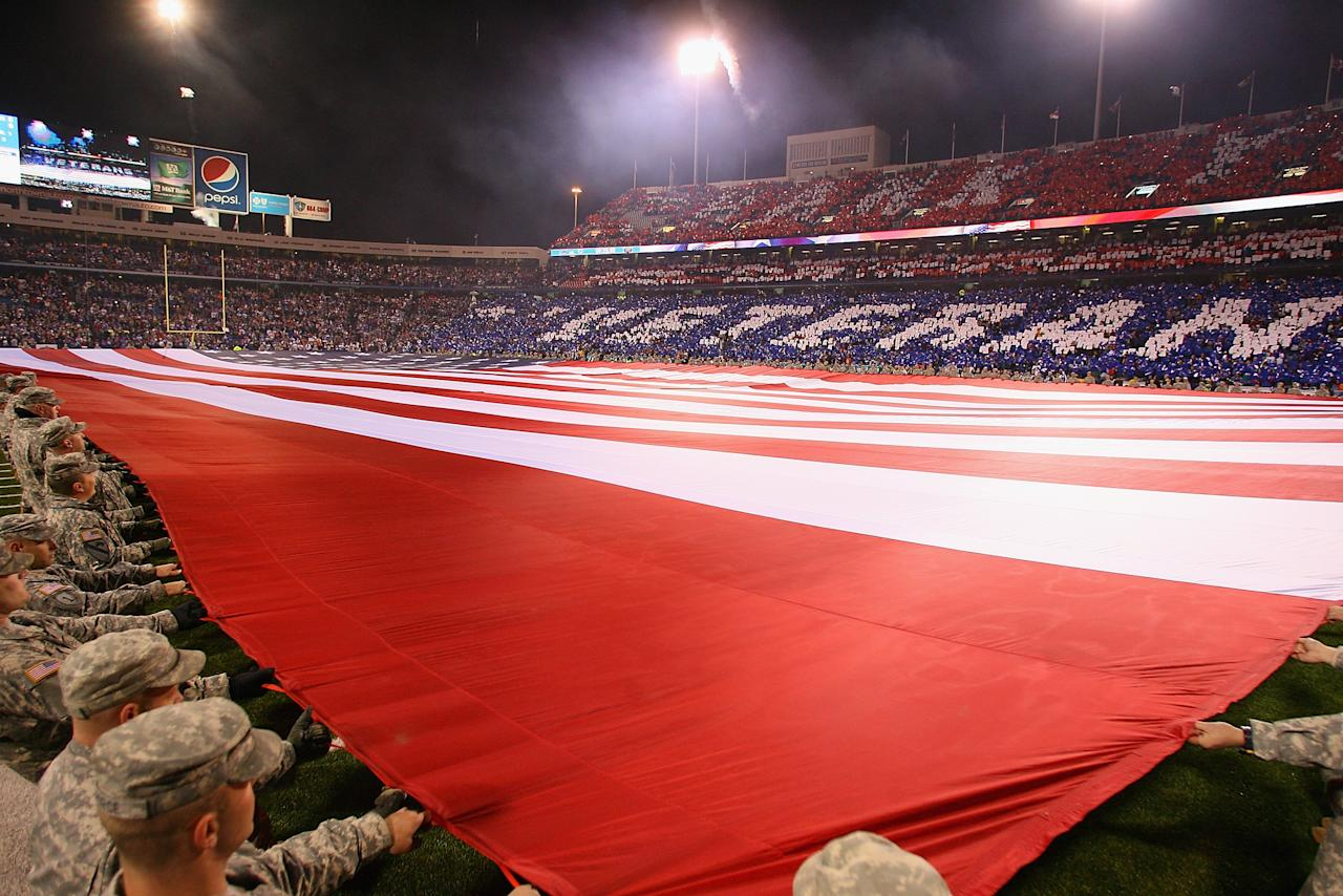 ORCHARD PARK, NY - NOVEMBER 15: Members of the Armed Forces hold the SuperFlag during the National Anthem at Ralph Wilson Stadium on November 15, 2012 in Orchard Park, New York.  (Photo by Rick Stewart/Getty Images)