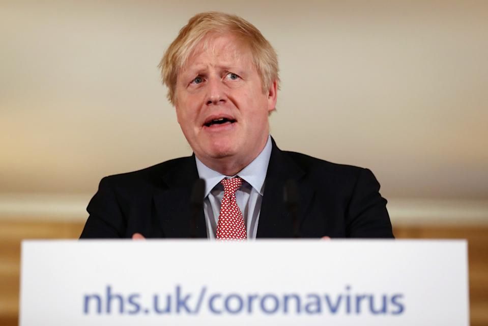 Britain's Prime Minister Boris Johnson speaks at a news conference addressing the government's response to the novel coronavirus COVID-19 outbreak, at 10 Downing Street in London on March 12, 2020. - Britain on Thursday said up to 10,000 people in the UK could be infected with the novel coronavirus COVID-19, as it announced new measures to slow the spread of the pandemic. (Photo by SIMON DAWSON / POOL / AFP) (Photo by SIMON DAWSON/POOL/AFP via Getty Images)