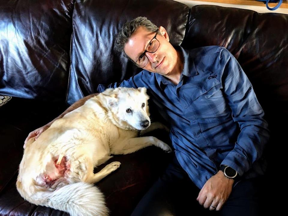 Rich McCue and his pet, Ms. Porkchop, after she was gored by a buck this week in a Gordon Head backyard in Victoria, B.C. (Rich McCue - image credit)