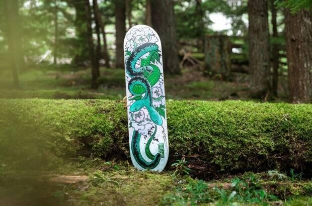 Squamish Nation artist Cory Douglas says his skateboard features a two-headed serpent from Squamish legend.