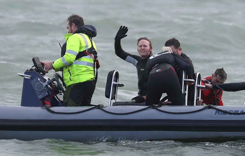 Former paratrooper John Bream (centre) waves to the press boat after setting the record for highest jump without a parachute by jumping 40m from a helicopter off Hayling Island in Hampshire. (Photo by Andrew Matthews/PA Images via Getty Images)