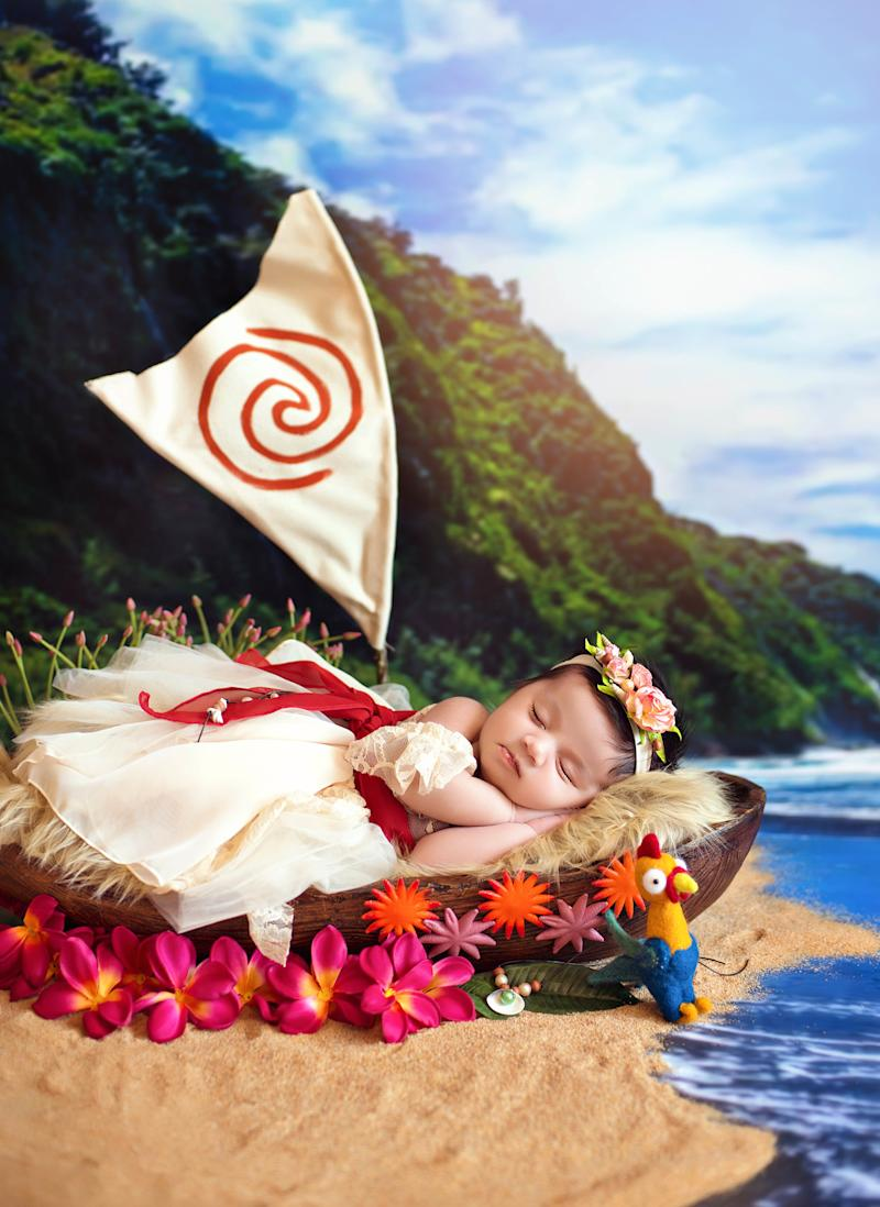 Baby Moana sleepily posed alongside the film's funny rooster character named Heihei. (Belly Beautiful Portraits)