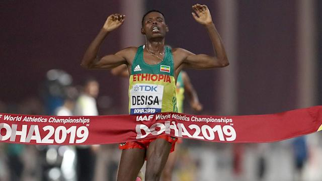Lelisa Desisa held off compatriot Mosinet Geremew to win the men's marathon at the World Athletics Championships.