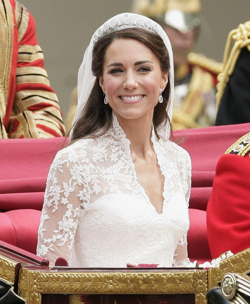 """<p><a href=""""https://www.goodhousekeeping.com/beauty/fashion/g4919/queen-elizabeth-wedding-gown/"""" rel=""""nofollow noopener"""" target=""""_blank"""" data-ylk=""""slk:Queen Elizabeth II"""" class=""""link rapid-noclick-resp"""">Queen Elizabeth II</a> lent the bride a pretty amazing """"something borrowed."""" The monarch originally received the Cartier Halo tiara on her 18th birthday and the gorgeous diadem includes nearly 1,000 diamonds.</p>"""