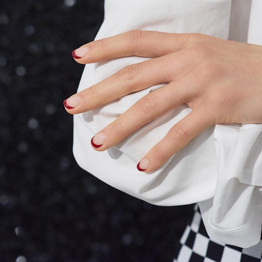 """Layer <a href=""""https://www.amazon.com/OPI-Infinite-Affair-Square-fl-oz/dp/B000O9XNO2"""" rel=""""nofollow noopener"""" target=""""_blank"""" data-ylk=""""slk:OPI Infinite Shine Nail Lacquer in An Affair in Red Square"""" class=""""link rapid-noclick-resp"""">OPI Infinite Shine Nail Lacquer in An Affair in Red Square</a> on just the tips."""