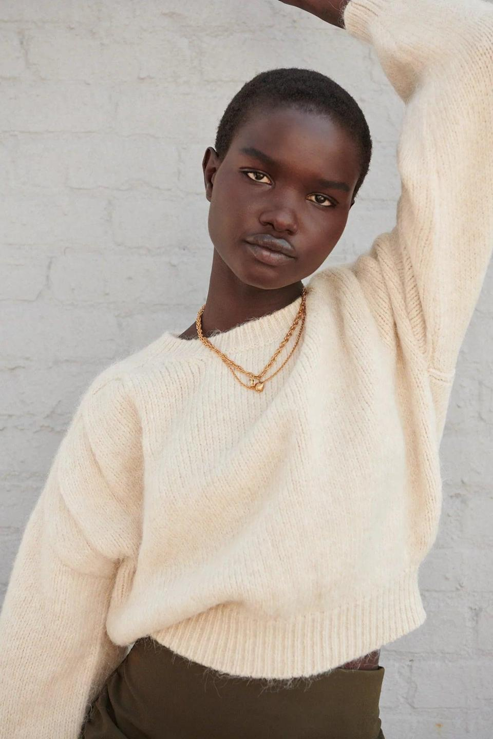 <p>A soft and comfortable beige sweater is a classic staple in any fall or winter wardrobe. This <span>Zara Ruched Shoulder Knit Sweater</span> ($46) is cozy and easy to style.</p>