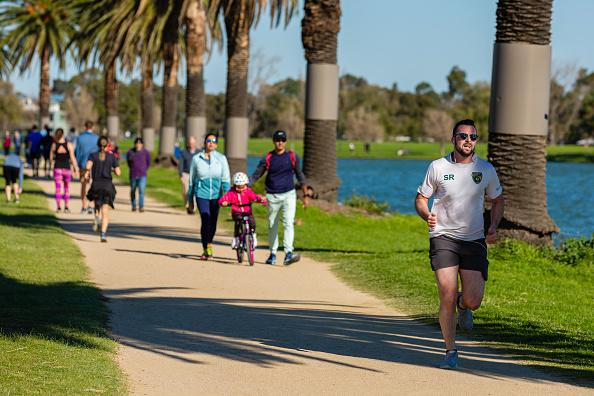 On the first weekend of partial freedom, joggers made the most of Melbourne's sunny Autumn weather at Albert Park Lake as restrictions are being eased in Victoria.