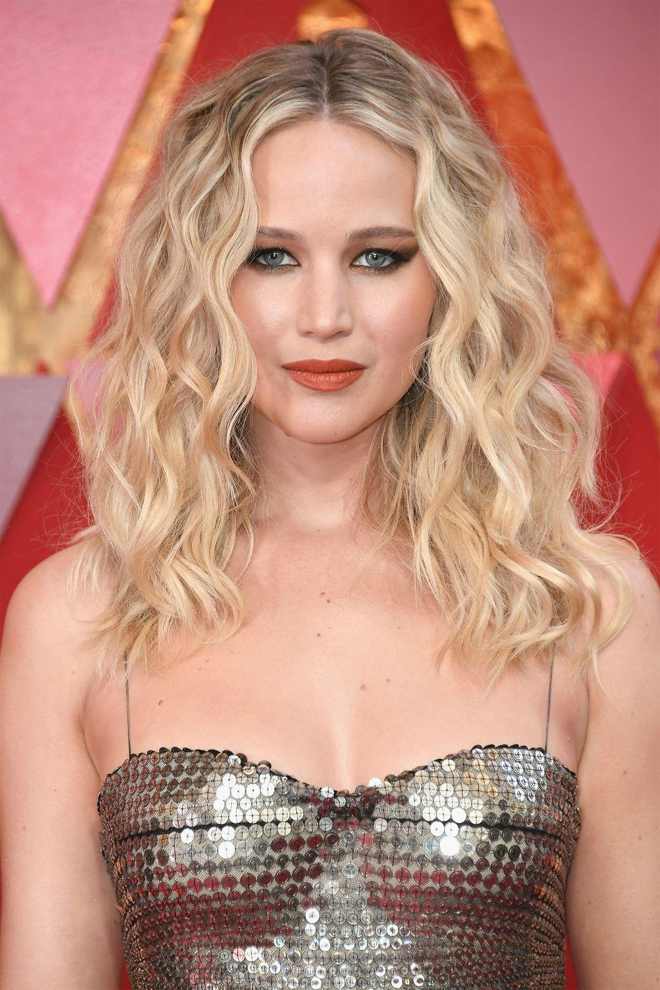 """<p>Lawrence ended her formal education when she was 14 and <a href=""""https://www.harpersbazaar.com/celebrity/latest/a18699077/jennifer-lawrence-dropped-out-middle-school/"""" rel=""""nofollow noopener"""" target=""""_blank"""" data-ylk=""""slk:dropped out of middle school"""" class=""""link rapid-noclick-resp"""">dropped out of middle school</a>.</p><p>""""I dropped out of middle school. I don't technically have a GED or a diploma,""""she explained during a <em>60 Minutes</em> interview. """"I am self-educated.""""</p>"""