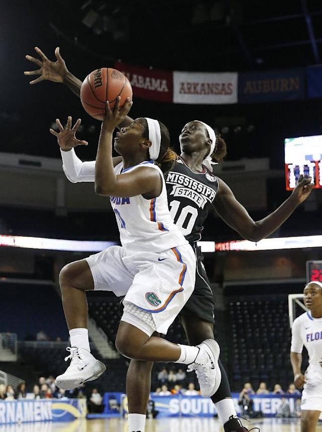 Florida guard Jaterra Bonds, left, drives past Mississippi State center Martha Alwal (10) as she goes up for a basket in the first half of a second-round women's Southeastern Conference tournament NCAA college basketball game Thursday, March 6, 2014, in Duluth, Ga. (AP Photo/John Bazemore)