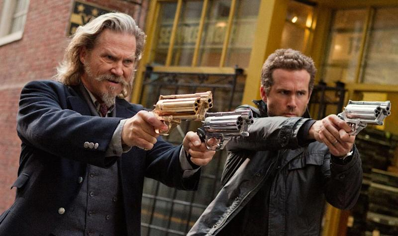 """This film publicity image released by Universal Pictures shows Jeff Bridges, left, and Ryan Reynolds in a scene from """"R.I.P.D."""" (AP Photo/Universal Pictures, Scott Garfield, File)"""