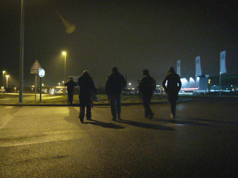 Unaccompanied minors walk in Calais during the night attempting to find a place to try climb aboard lorries without being intimidated by potential people traffickers: Sue Clayton